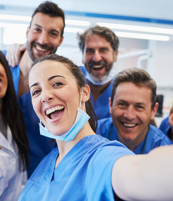 A team of healthcare professionals taking a selfie together